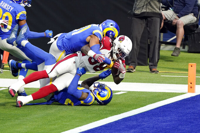 Arizona Cardinals running back Jonathan Ward scores a rushing touchdown against the Los Angeles Rams during the first half of an NFL football game Sunday, Jan. 3, 2021, in Inglewood, Calif. (AP Photo/Ashley Landis)