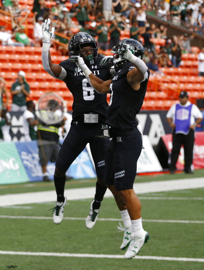 Hawaii wide receiver Cedric Byrd II (6) and wide receiver Jason-Matthew Sharsh (3) celebrate a firs-quarter touchdown against Arizona during an NCAA college football game Saturday, Aug. 24, 2019, in Honolulu. (AP Photo/Marco Garcia)