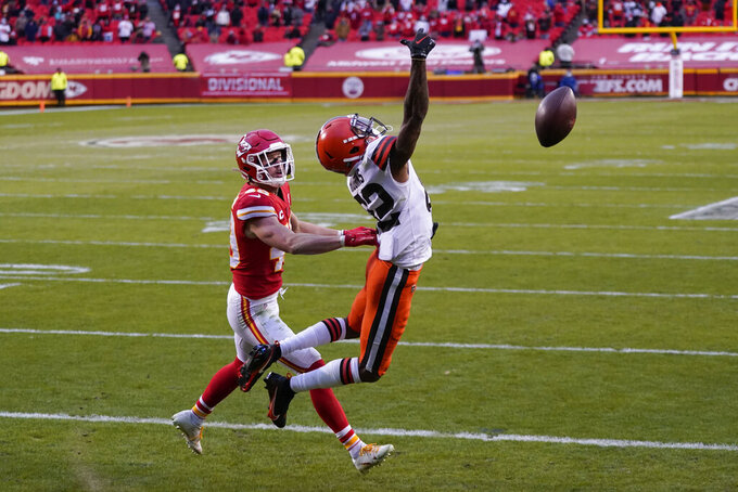 Kansas City Chiefs safety Daniel Sorensen, left, breaks up a pass intended for Cleveland Browns wide receiver Rashard Higgins, right, during the second half of an NFL divisional round football game, Sunday, Jan. 17, 2021, in Kansas City. (AP Photo/Jeff Roberson)