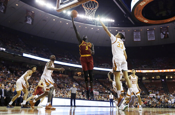 Iowa State guard Marial Shayok (3) scores past Texas forward Kamaka Hepa (33) during the first half of an NCAA college basketball game, Saturday, March 2, 2019, in Austin, Texas. (AP Photo/Eric Gay)