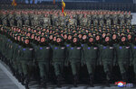 In this photo provided by the North Korean government, North Korean soldiers march in formation during a military parade marking the ruling party congress, at Kim Il Sung Square in Pyongyang, North Korea Thursday, Jan. 14, 2021. North Korea rolled out developmental ballistic missiles designed to be launched from submarines and other military hardware in a parade that punctuated leader Kim Jong Un's defiant calls to expand his nuclear weapons program. Independent journalists were not given access to cover the event depicted in this image distributed by the North Korean government. The content of this image is as provided and cannot be independently verified. Korean language watermark on image as provided by source reads: