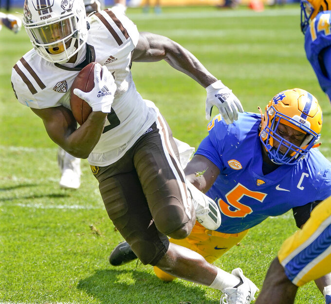 Western Michigan running back Sean Tyler (9) gets past Pittsburgh defensive lineman Deslin Alexandre (5) for a touchdown during the first half of an NCAA college football game, Saturday, Sept. 18, 2021, in Pittsburgh. (AP Photo/Keith Srakocic)