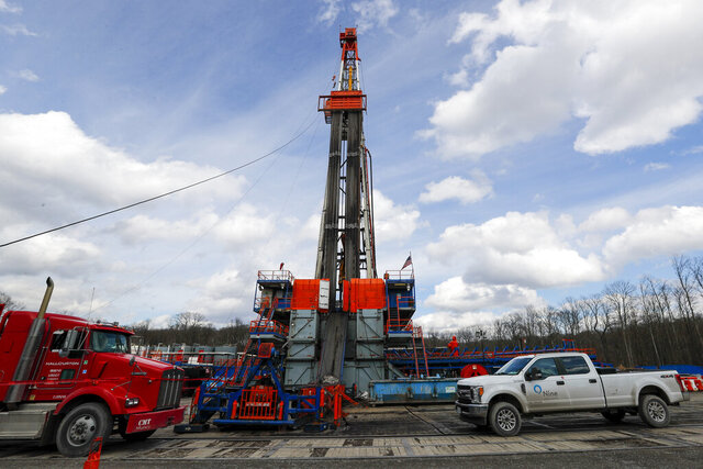 FILE—In this file photo from March 12, 2020, work continues at a shale gas well drilling site in St. Mary's, Pa. Pennsylvania attorney general Josh Shapiro is scheduled to release results on Thursday June 25, 2020 of a grand jury investigation into natural gas hydraulic fracturing. The fracking process has raised environmental concerns while turning the state into a major energy producer. (AP Photo/Keith Srakocic, File)