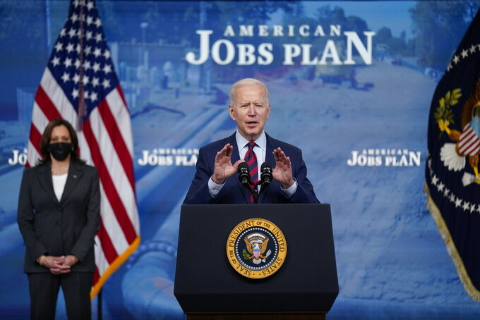 President Joe Biden speaks during an event on the American Jobs Plan in the South Court Auditorium on the White House campus, Wednesday, April 7, 2021, in Washington. Vice President Kamala Harris is at left. (AP Photo/Evan Vucci)