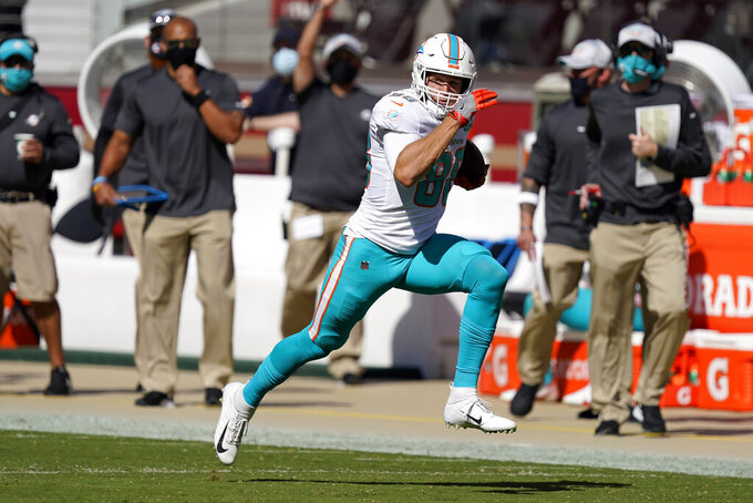 Miami Dolphins tight end Mike Gesicki (88) runs against the San Francisco 49ers during the first half of an NFL football game in Santa Clara, Calif., Sunday, Oct. 11, 2020. (AP Photo/Tony Avelar)