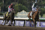 Joe Bravo, right, aboard Blue Prize celebrates after winning the Breeders' Cup Distaff horse race at Santa Anita Park, Saturday, Nov. 2, 2019, in Arcadia, Calif. (AP Photo/Gregory Bull)