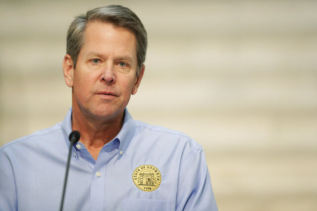 Georgia Gov. Brian Kemp speaks about the COVID-19 virus during a news conference at the Georgia state Capitol on Wednesday, April 8, 2020, in Atlanta. (AP Photo/Brynn Anderson)