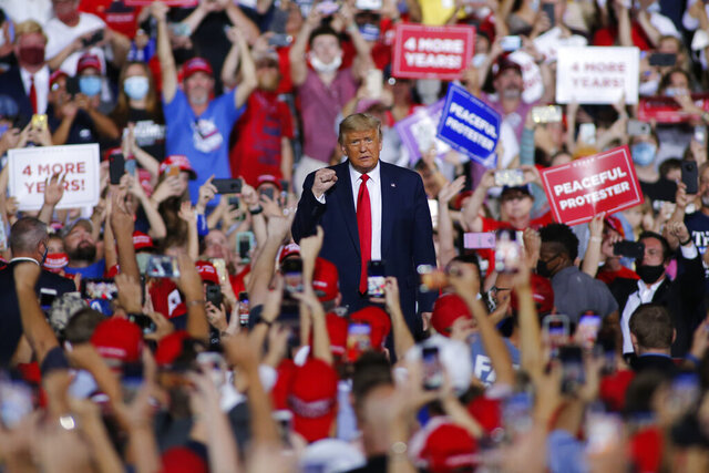 President Donald Trump arrives to speak at a campaign rally in Gastonia, N.C., Wednesday, Oct. 21, 2020. (AP Photo/Nell Redmond)