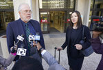 Geoffrey Carr, left, and May Mar attorney's for Tiffany Li, talks with reporters outside the courthouse after opening statements were delayed in Li's trial, Thursday, Sept. 12, 2019, in Redwood City, Calif.  Li, a Chinese real estate scion, posted a $35 million bail after being charged with orchestrating the 2016 murder of her children's father. (AP Photo/Tony Avelar)