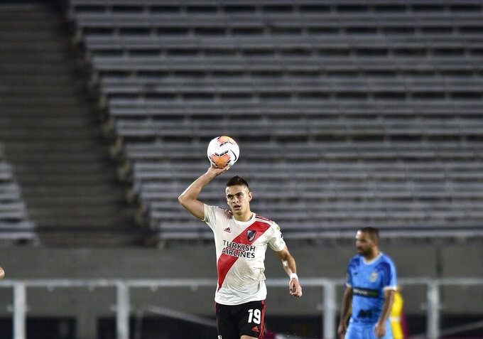 Rafael Borre of Argentina's River Plate celebrates a goal scored by Milton Casco against Peru's Binacional during a Copa Libertadores Group D soccer match at the Antonio Vespucio Liberti stadium in Buenos Aires, Argentina, Wednesday, March 11, 2020. The game was played in an empty, closed door stadium, as punishment for the violent incidents that happened during the 2018 Libertadores final against town rivals Boca Juniors. (AP Photo/Gustavo Garello)