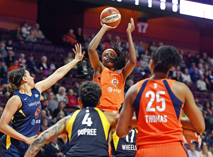 FILE - In this May 28, 2019, file photo, Connecticut Sun center Jonquel Jones shoots over the Indiana Fever defense during a WNBA basketball game, in Uncasville, Conn. Led by Jones, the Sun (8-1) have won their last six games and have started to put a little distance between themselves and the rest of the league. (Sean D. Elliot/The Day via AP, File)