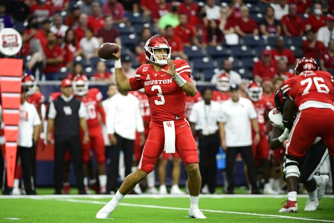 Houston quarterback Clayton Tune (3) throws a pass against Texas Tech during the first half of an NCAA college football game Saturday, Sept. 4, 2021, in Houston. (AP Photo/Justin Rex)