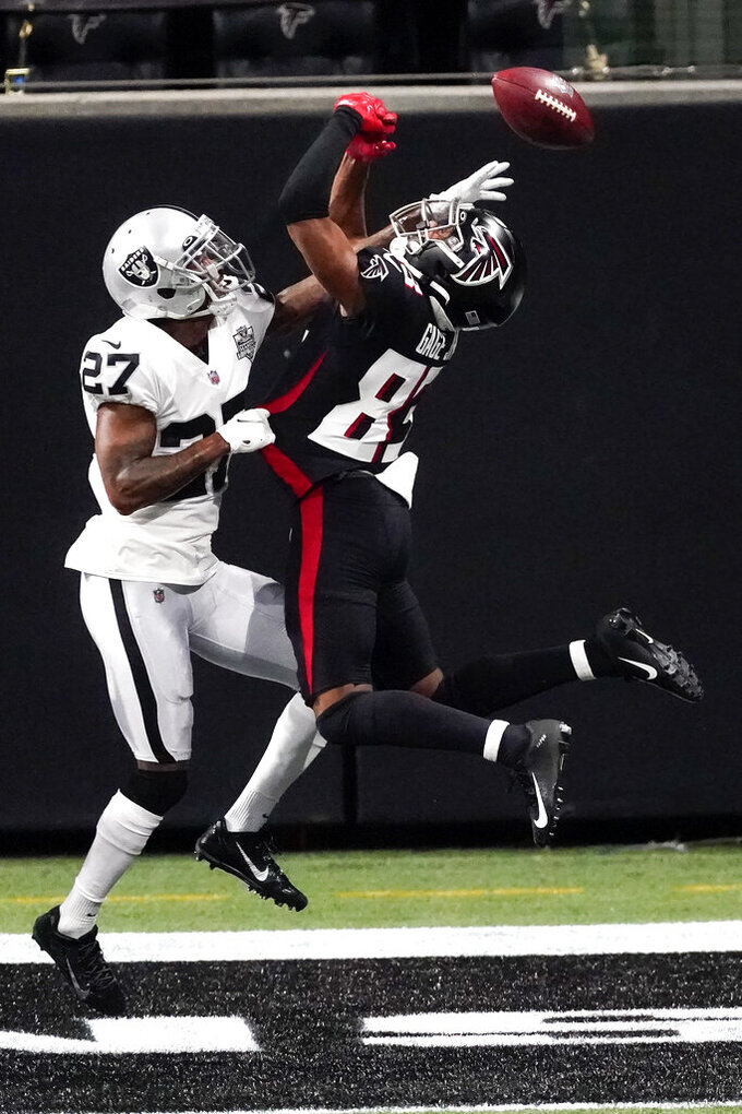 Atlanta Falcons wide receiver Russell Gage (83) misses the catch in the end zone against Las Vegas Raiders cornerback Trayvon Mullen (27) during the first half of an NFL football game, Sunday, Nov. 29, 2020, in Atlanta. (AP Photo/John Bazemore)