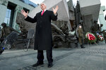 United States Vice President Mike Pence speaks during a statement in front of the 'Warsaw Uprising Monument' in Warsaw, Poland, Thursday, Feb. 14, 2019. The Polish capital is host for a two-day international conference on the Middle East, co-organized by Poland and the United States. (AP Photo/Michael Sohn)