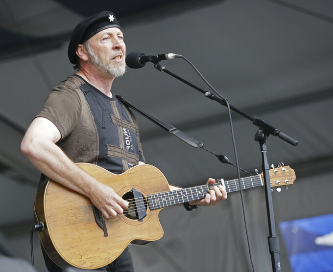 "FILE - Richard Thompson performs during the 2008 New Orleans Jazz & Heritage Festival at the New Orleans Fairgrounds Racetrack in New Orleans, on May 2, 2008. Thompson's book ""Beeswing: Losing My Way and Finding My Voice 1967–1975"" released on April 6. (AP Photo/Dave Martin, File)"