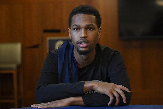 "Georgetown's Terrell Allen speaks during an NCAA college basketball media availability, Wednesday, Dec. 11, 2019, in Washington.  It was hard not to do a double-take when Georgetown basketball coach Patrick Ewing replied to a question Wednesday about whether his full roster will be available for the team's next game, against Syracuse, by saying, ""As of now, yes."" That'll be the Hoyas' first home contest since legal matters involving players came to light. (AP Photo/Nick Wass)"
