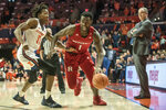 Rutgers' Akwasi Yeboah (1) drives the ball against Illinois' Ayo Dosunmu (11) as Rutgers head coach Steve Pikiell watches on the sideline in the second half of an NCAA college basketball game, Sunday, Jan. 11, 2020, in Champaign, Ill. (AP Photo/Holly Hart)
