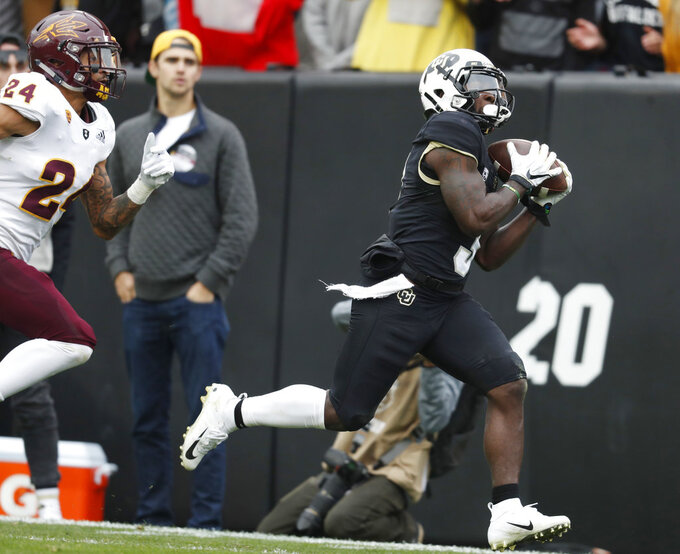 Colorado wide receiver K.D. Nixon, right, pulls in a pass as Arizona State defensive back Chase Lucas pursues in the second half of an NCAA college football game Saturday, Oct. 6, 2018, in Boulder, Colo. Colorado won 28-21. (AP Photo/David Zalubowski)