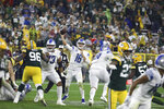 Detroit Lions quarterback Jared Goff (16) throws a pass to wide receiver Amon-Ra St. Brown (14) against the Green Bay Packers during an NFL football game on Monday, Sept. 20, 2021, in Green Bay, Wis. (Adam Niemi/The Daily Mining Gazette via AP)