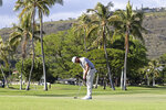 Chris Kirk putts on the 13th green during the third round at the Sony Open golf tournament Saturday, Jan. 16, 2021, in Honolulu. (AP Photo/Marco Garcia)