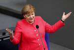 German Chancellor Angela Merkel takes questions as part of a meeting of the German federal parliament, Bundestag, at the Reichstag building in Berlin, Germany, Wednesday, July 1, 2020. (AP Photo/Michael Sohn)