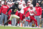 Nebraska wide receiver JD Spielman (10) gets past Purdue safety Cory Trice (23) after a catch during the first half of an NCAA college football game in West Lafayette, Ind., Saturday, Nov. 2, 2019. (AP Photo/Michael Conroy)