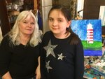 Charlotte Byrdfeather poses with student Anastasia Tamm at the Studio 76 Artists Group in White House, Tenn. on March 5, 2019. Tamm started drawing at three, graduated to painting at six and hopes have a career as a Disney animator someday. (Nicole Young /The Tennessean via AP)