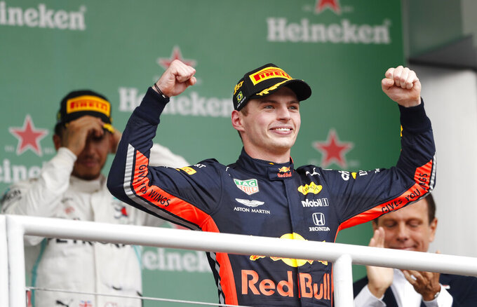 Red Bull driver Max Verstappen, of the Netherlands,center, celebrates at the podium after winning the Brazilian Formula One Grand Prix at the Interlagos race track in Sao Paulo, Brazil, Sunday, Nov. 17, 2019. (AP Photo/Nelson Antoine)