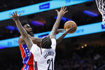 Philadelphia 76ers' Norvel Pelle, left, tries to get a shot past Brooklyn Nets' Wilson Chandler during the first half of an NBA basketball game, Wednesday, Jan. 15, 2020, in Philadelphia. (AP Photo/Matt Slocum)