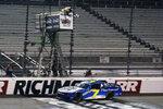 Justin Allgaier (7) crosses the finish line to win a NASCAR Xfinity Series auto race Friday, Sept. 11, 2020, in Richmond, Va. (AP Photo/Steve Helber)