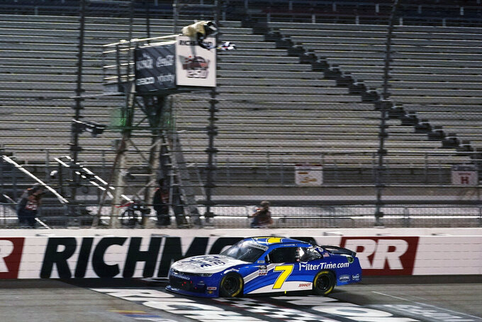 Justin Allgaier (7) crosses the finish line to win a NASCAR Xfinity Series auto race Friday, Sept. 11, 2020, in Richmond, Va. (AP Photo/Steve Helber)