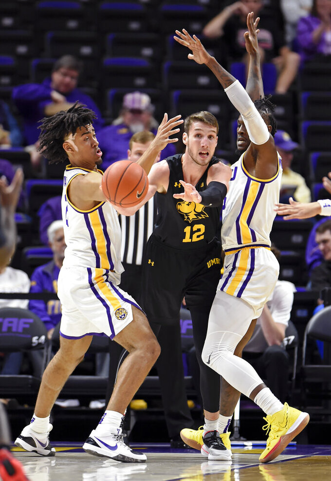 UMBC guard Brandon Horvath (12) looks to make the outlet pass as LSU forwards Trendon Watford, left, Emmitt Williams, right, apply pressure during the first half of an NCAA college basketball game Tuesday, Nov. 19, 2019, in Baton Rouge, La. (AP Photo/Bill Feig)