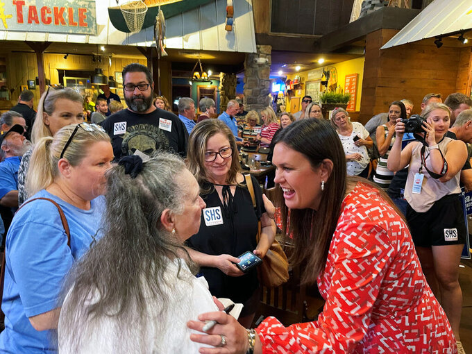 Former White House Press Secretary Sarah Sanders greets supporters at an event for her campaign for governor at a Colton's Steak House in Cabot, Ark., Friday, Sept. 10, 2021. (AP Photo/Andrew DeMillo)