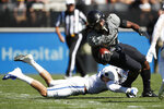 Air Force defensive back Grant Theil, left, knocks down Colorado wide receiver Laviska Shenault Jr. in the first half of an NCAA college football game Saturday, Sept. 14, 2019, in Boulder, Colo. (AP Photo/David Zalubowski)