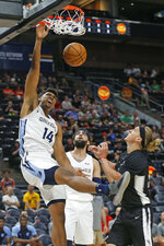 Memphis Grizzlies center Doral Moore (14) dunks as San Antonio Spurs guard Jeff Ledbetter, right, watches during the first half of an NBA Summer League basketball game Tuesday, July 2, 2019, in Salt Lake City. (AP Photo/Rick Bowmer)