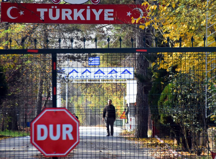 An man who is identified by Turkish news reports as a U.S. citizen who has been deported by Turkey and is now stuck in the heavily militarized no-man's land between Greece and Turkey, after Greece refused to take him in, near Pazarkule border gate, Edirne, Turkey, Monday Nov. 11, 2019.   Ankara began deporting captured foreign IS fighters, and asked to comment on the reports, Erdogan said:
