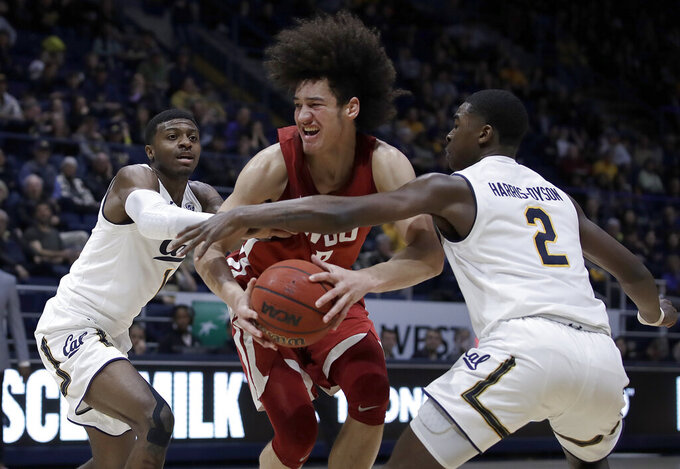 Washington State's CJ Elleby, center, drives the ball between California's Darius McNeill, left, and Juhwan Harris-Dyson (2) in the second half of an NCAA college basketball game Saturday, March 2, 2019, in Berkeley, Calif. (AP Photo/Ben Margot)