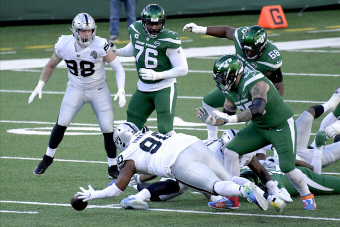 Las Vegas Raiders' Johnathan Hankins (90), bottom center, jumps on a loose ball during the first half an NFL football game against the New York Jets, Sunday, Dec. 6, 2020, in East Rutherford, N.J. (AP Photo/Bill Kostroun)