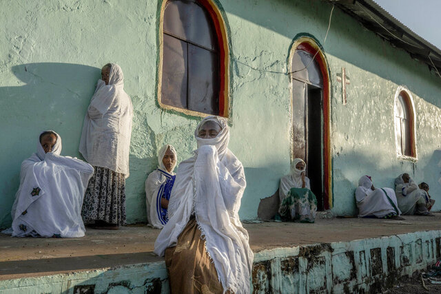 Tigrayan women who fled the conflict in Ethiopia's Tigray region, pray during Sunday Mass at a church, near Umm Rakouba refugee camp in Qadarif, eastern Sudan, Nov. 29, 2020. (AP Photo/Nariman El-Mofty)