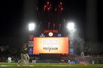 Fireworks go off behind the scoreboard at Oracle Park after the San Francisco Giants defeated the San Diego Padres in a baseball game to clinch a postseason berth in San Francisco, Monday, Sept. 13, 2021. (AP Photo/Jeff Chiu)