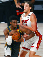 Miami Heat's Kelly Olynyk, right, fouls Oklahoma City Thunder's Hamidou Diallo during the second half of an NBA basketball game Wednesday, Aug. 12, 2020, in Lake Buena Vista, Fla. (Kevin C. Cox/Pool Photo via AP)