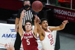 Utah guard Alfonso Plummer (25) and Stanford guard Michael O'Connell (5) battle for a rebound in the first half during an NCAA college basketball game Thursday, Jan. 14, 2021, in Salt Lake City. (AP Photo/Rick Bowmer)