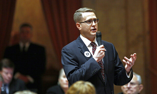 FILE - In this Feb. 8, 2012, file photo, state Rep. Matt Shea, R-Spokane Valley, speaks at the Capitol in Olympia, Wash. Shea, a right-wing lawmaker from Washington state said Friday, Jan. 10, 2020 that a recent report that branded him a ''domestic terrorist'' is a lie and that he will continue to represent the people of his district. (AP Photo/Elaine Thompson, File)