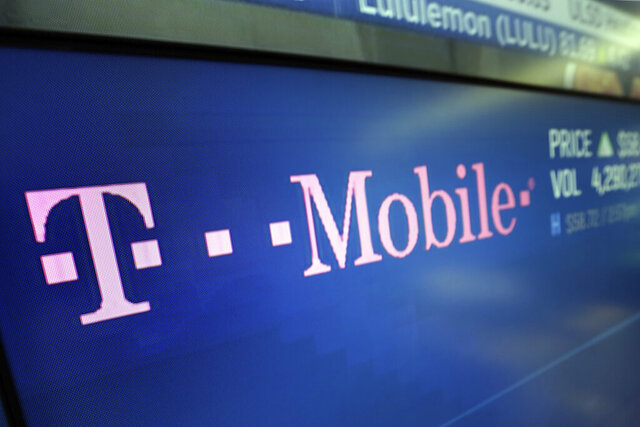 "In this Feb. 14, 2018, photo, the logo for T-Mobile appears on a screen at the Nasdaq MarketSite in New York. T-Mobile, one of the three largest mobile carriers in the U.S., said it's working to fix a widespread network issue. The company's president of technology, Neville Ray, tweeted Monday afternoon, June 15, 2020, at around 4 p.m. Eastern Daylight Time that T-Mobile engineers hope to fix the ""voice and data issue"" soon. (AP Photo/Richard Drew)"