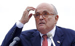 FILE - In this Aug. 1, 2018 file photo, Rudy Giuliani, an attorney for President Donald Trump, addresses a gathering during a campaign event for Eddie Edwards, who is running for the U.S. Congress, in Portsmouth, N.H. Lawyers speaking publicly on behalf of President Donald Trump and his longtime