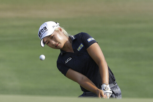 FILE - In this June 2, 2019, file photo, Jeongeun Lee6, of South Korea, chips to the 16th green during the final round of the U.S. Women's Open golf tournament, in Charleston, S.C. Without qualifying this year because of the COVID-19 pandemic, the USGA released exemption categories for this year's Women's Open on Dec. 10-13 in Houston.(AP Photo/Steve Helber, File)