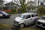 Wrecked vehicles are seen after a driver struck and injured at least five people over a 20-block stretch of Southeast Portland, Ore., before crashing and fleeing on Monday, Jan. 25, 2021, according to witnesses. (Beth Nakamura/The Oregonian via AP)