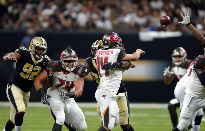 New Orleans Saints defensive tackle David Onyemata commits a late hit on Tampa Bay Buccaneers quarterback Ryan Fitzpatrick (14) which resulted in a penalty and a scuffle in the second half of an NFL football game in New Orleans, Sunday, Sept. 9, 2018. (AP Photo/Bill Feig)