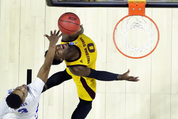 Arizona State's Luguentz Dort (0) heads to the basket past Buffalo's Jayvon Graves (3) during the first half of a first round men's college basketball game in the NCAA Tournament Friday, March 22, 2019, in Tulsa, Okla. (AP Photo/Jeff Roberson)
