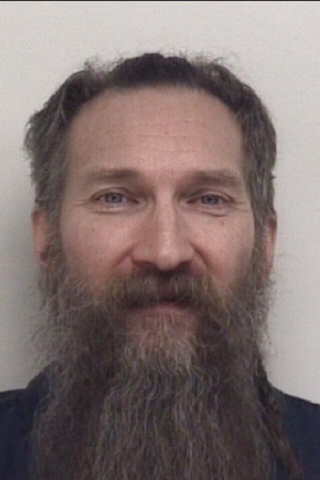 FILE- This undated booking photo provided by the Shiawassee County, Mich., Sheriff's Office shows Mark Latunski. Latunski is charged with killing and mutilating a man whom he met through a dating app. (Shiawassee County Sheriff's Office/via AP)